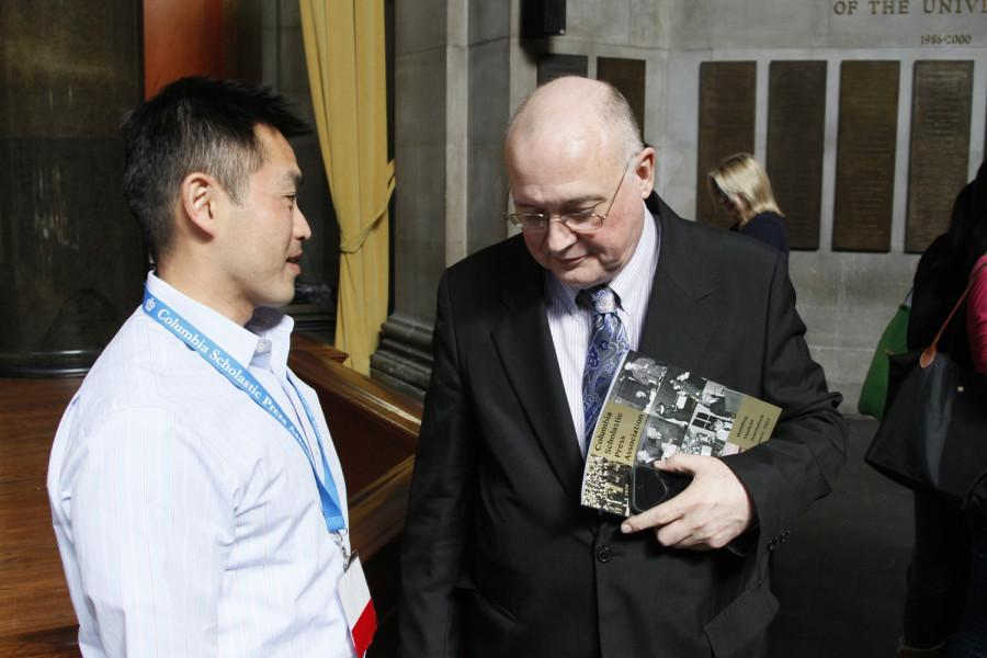 CSPA Executive Director Ed Sullivan (on the right) speaks with Steven Le, an adviser of the 2014 EJS Award recipient, the staff of the Global Vantage Magazine.